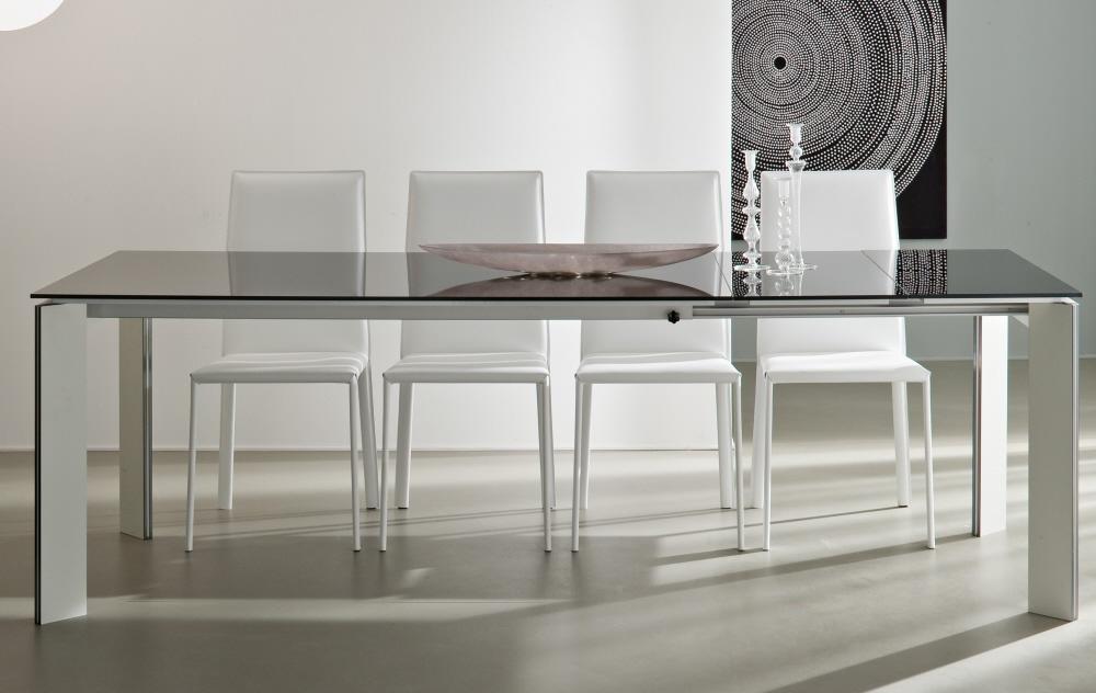 Tavoli allungabili moderni con base legno piani vetro legno for Piani moderni in vetro
